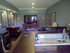 Custom basement finishing project with bar and home theater