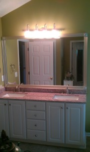 After new vanity top, new faucets, and added a beautiful frame around the mirror, this bathroom has a whole new look!