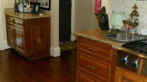 Kitchen remodeling featuring granite countertops with tile backsplash and cooktop