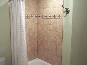 Bathroom remodel featuring beautiful tile work on the walk-in shower